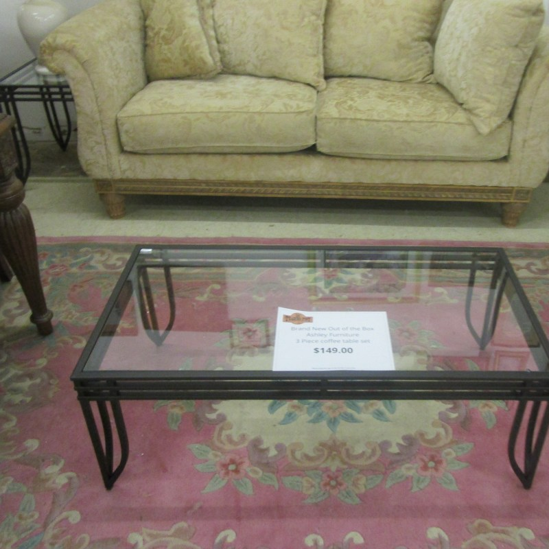 3 piece coffee table set by Ashley Furniture